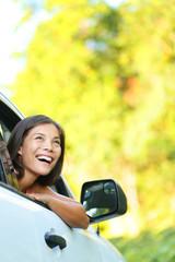 Car woman on road trip looking