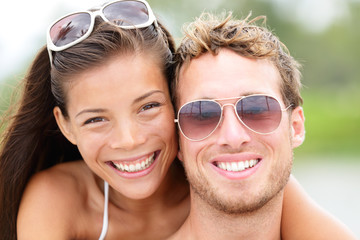 Happy young beach couple closeup portrait