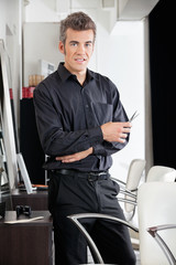 Male Hairstylist With Scissors At Salon