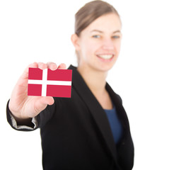 business woman holding a card with the Danish flag