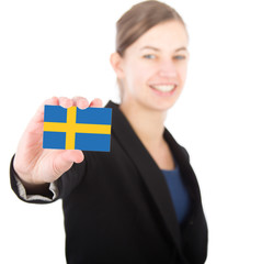 business woman holding a card with the Swedish flag