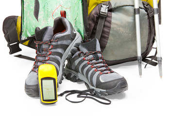 Tourist equipment: backpack; shoes; map; gps on white background