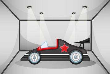 A black luxury car inside a garage