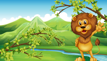 A lion in front of the river and the high mountains