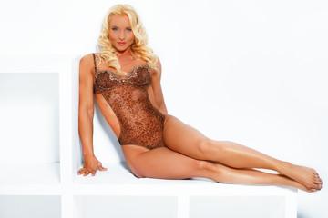 Sensual alluring woman in leopard lingerie