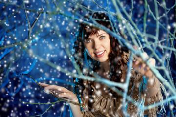 Beauty woman in winter forest
