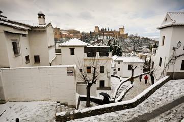 Snow storm with slush on sidewalks. Granada