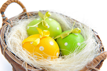 Easter eggs are in a trug on a white background
