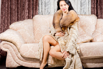 Glamorous woman in a fur coat