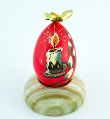 Wooden Easter egg on a stand made of onyx