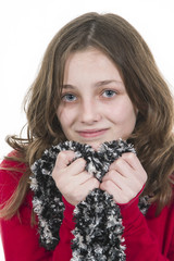 Pre teen girl posing with scarf held to chin