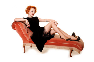 beautiful retro redhead on chaise longue