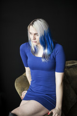 Beautiful Young Woman with Blue Hair and Very Short Blue Dress