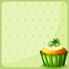 A stationery with a green cupcake