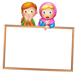 An empty framed white board with two girls