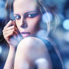 Young sensual model girl. Color face art studio photo.