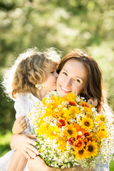 Woman and child with bouquet of flowers