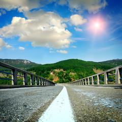asphalt road with the sky