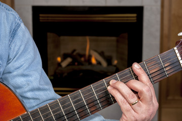 Guitarist plays music on an Acoustic guitar
