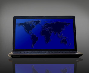Laptop with map isolated on dark background