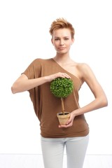 Trendy woman holding potted plant