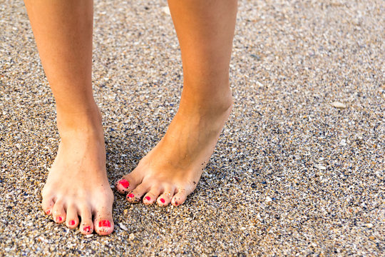 Shy Girl Feet Standing In Sand