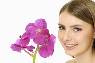 Young girl with beautiful makeup and pink orchids.