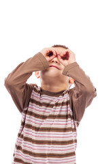 Cute little boy  making an imaginary binocular with hands