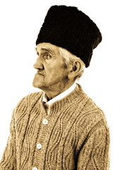Close-up portrait of an old peasant man with wooly hat