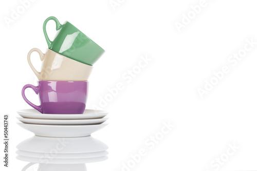 bunte gestapelte kaffee tassen auf weissem hintergrund stockfotos und lizenzfreie bilder auf. Black Bedroom Furniture Sets. Home Design Ideas