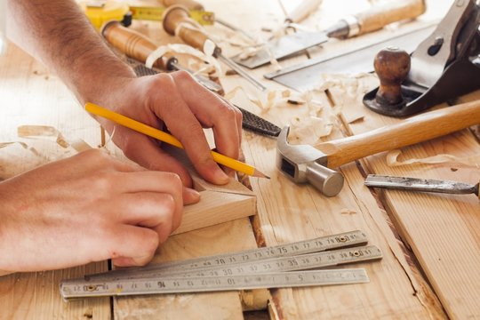 carpenter working,hammer and meter  on construction background