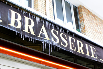 French brasserie sign with icicles