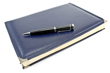 Pen and blue notebook