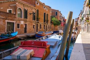 A venetian street full par parked boats