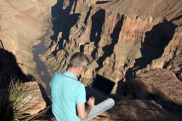 Business man at Grand Canyon