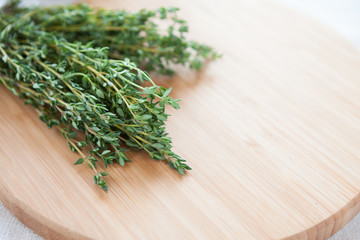 sprigs of thyme on the board
