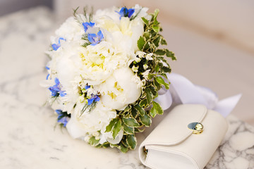 Wedding bouquet of white peonies