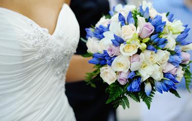wedding bouquet  in the hands of bride