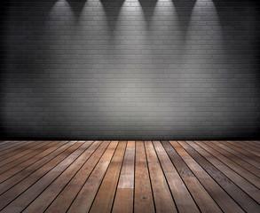 Graue Ziegelwand mit Holzfussboden, Lichtstrahler