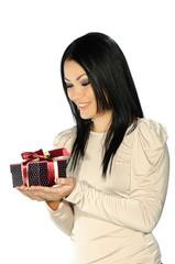 Beautiful brunette holding a present box