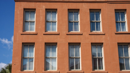 Windows in Old Red Stucco Building