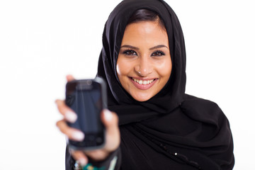 muslim girl holding smart phone
