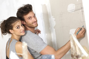 Loving couple planning new house