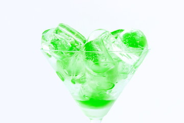 Cup with green ice cubes