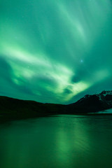 Wall Murals Green coral Northern lights above lagoon in Iceland