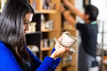 Customer holding a Cup in a gift shop