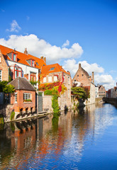 Beautiful view of a canal and , bridge, red roofs in Bruges, Bel