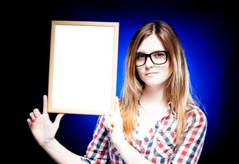 Woman with nerd glasses holding empty frame, copyspace