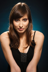 Young woman portrait isolated on blue background