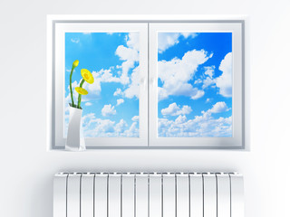 window with cloudy sky and flowers on sill